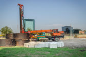 Construction site machinery crane cement blocks  — Stock Photo