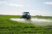 Tractor spray fertilize field pesticide chemical  — Stock Photo
