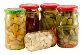Set jars of pickled vegetables for winter resource  — Stock Photo