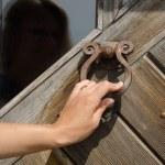 Hand knock retro rusty door handle ringer knocker  — Stock Photo #46033923