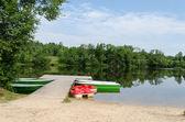 Wooden footbridge and anchored boats water bikes   — ストック写真