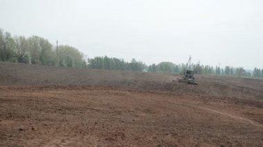 Tractor harrow field — Stock Video