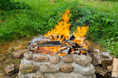 Stone wall fireplaces  quiet burn firewood  — Stock Photo