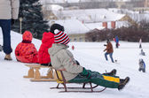 Children sit wooden sledge ready slide from hill  — Stock Photo