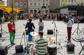 Group perform on street and people listen concert  — Stock Photo