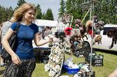 Young woman browse fair handmade wares — Stock Photo
