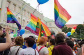Gay lesbian marchers holding flags balloons — Stock Photo