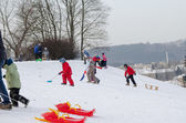 Active children fun in winter on hill with sledge  — Stock Photo