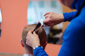 Man haircut at the barber scissors — Stock Photo