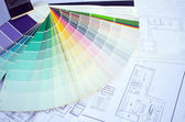 Color palette samples lie on house design drawings  — Stock Photo