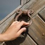 Guest hand knock retro door handle buzzer ringer — Stock Photo
