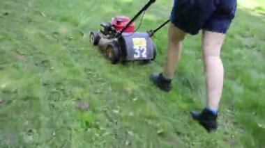 Walk woman cut grass — Stockvideo