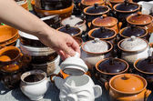 Handmade clay pots and woman hand hold clay lit   — Foto Stock