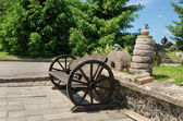 Bench wheel carriage rail stacked tower millstones — Stock Photo
