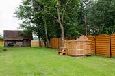 Wooden hot tub water rural yard. outdoor pleasure.  — Stockfoto
