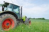 Field work tractor in meadow  — Stock fotografie
