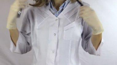 Nurse white uniform and stethoscope uncover white sterile glove — Stock Video