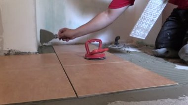 Construction worker place floor tiles. Home renovation — Stock Video