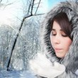 Young Girl Outdoor Blowing Snow . Beautiful Winter — Stock Photo