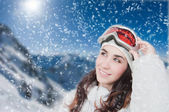 Portrait of young smiling woman against a background of the mountains — Stock Photo