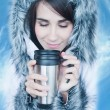 Woman drinking hot coffee or tea outdoors in winter. — Stock Photo
