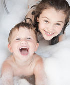Brother and sister taking a bubble bath — Stock Photo