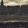 Ruins of a small amphitheater in Pompeii, Italy - Stock Photo