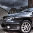 Black car in the rain, hdr image — Stock Photo