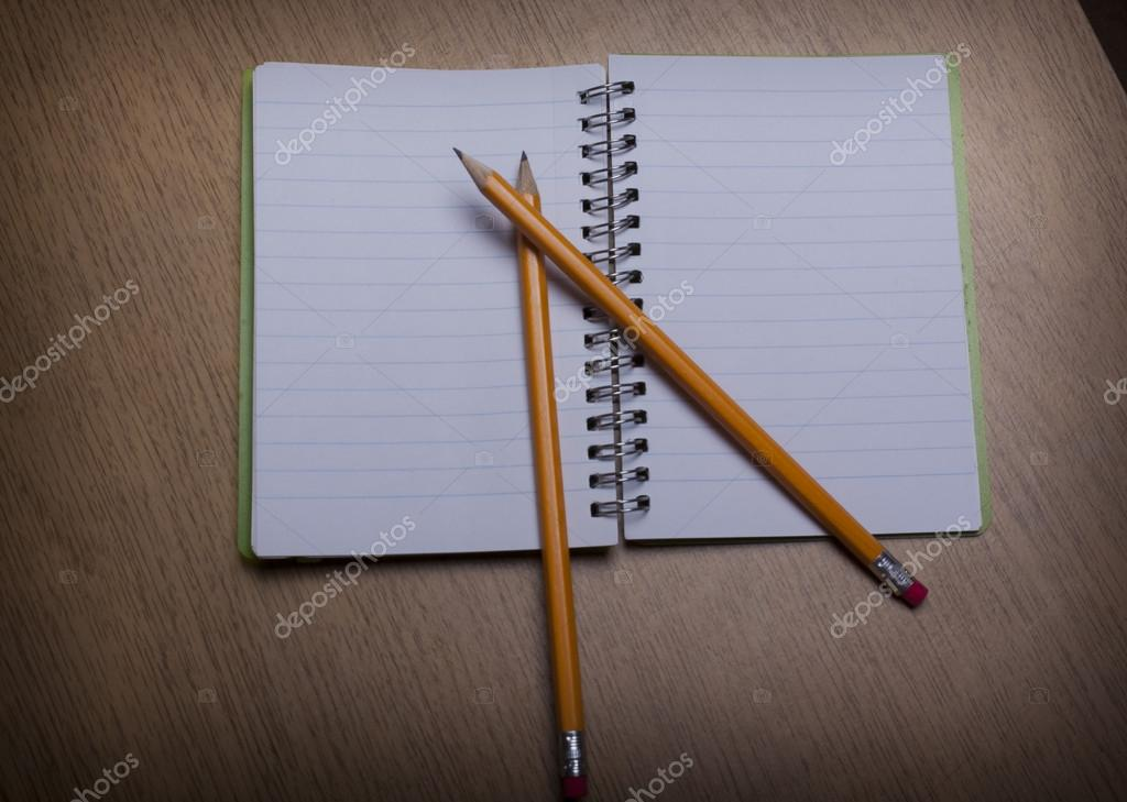 Open  notebook on a wooden desk with pencil — Stock Photo #13086171