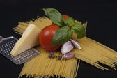 Spaghetti pasta, tomato, basil, garlic and cheese — Stock Photo