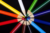 Color pencils isolated on black background — Stockfoto