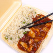 Take away chinese sweet and sour chicken with rice — Stock Photo
