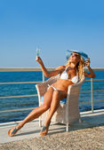 Sexy woman relaxing on Mediterranean coast in sunny day — Stock Photo