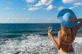 Sexy woman in bikini looking at the sea. — Stock Photo