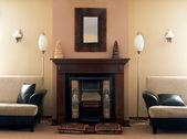 Luxury fireplace room — Stock Photo