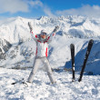 Stock Photo: Cheerful skier on top of mountain Pirin
