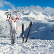 Stock Photo: Smiling skier posing on the top of mountain Pirin