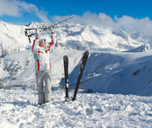 Smiling skier posing on the top of mountain Pirin — Stock Photo
