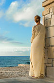 Greek style woman looking for the sea — Stock Photo