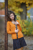The girl with the clarinet in his hands — Stock Photo