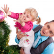 Happy family having fun with Christmas presents — Stock Photo