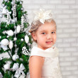 Pretty little girl  near the new year tree — Foto Stock