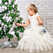 Pretty little girl  near the new year tree — Stock fotografie