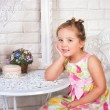 Cute little girl with spring flowers — Stock Photo