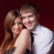 Couple embracing on the red background — Stock Photo #8756438