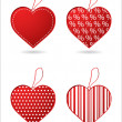 Set of four red hearts with special design — 图库矢量图片