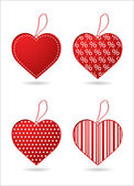Set of four red hearts with special design — Stockvektor