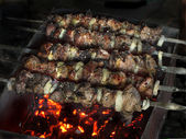 Kebab meat skewered over a fire — Stock Photo