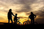 On bikes at sunset. — Stock Photo