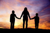 Family watching sunset. — Stock Photo